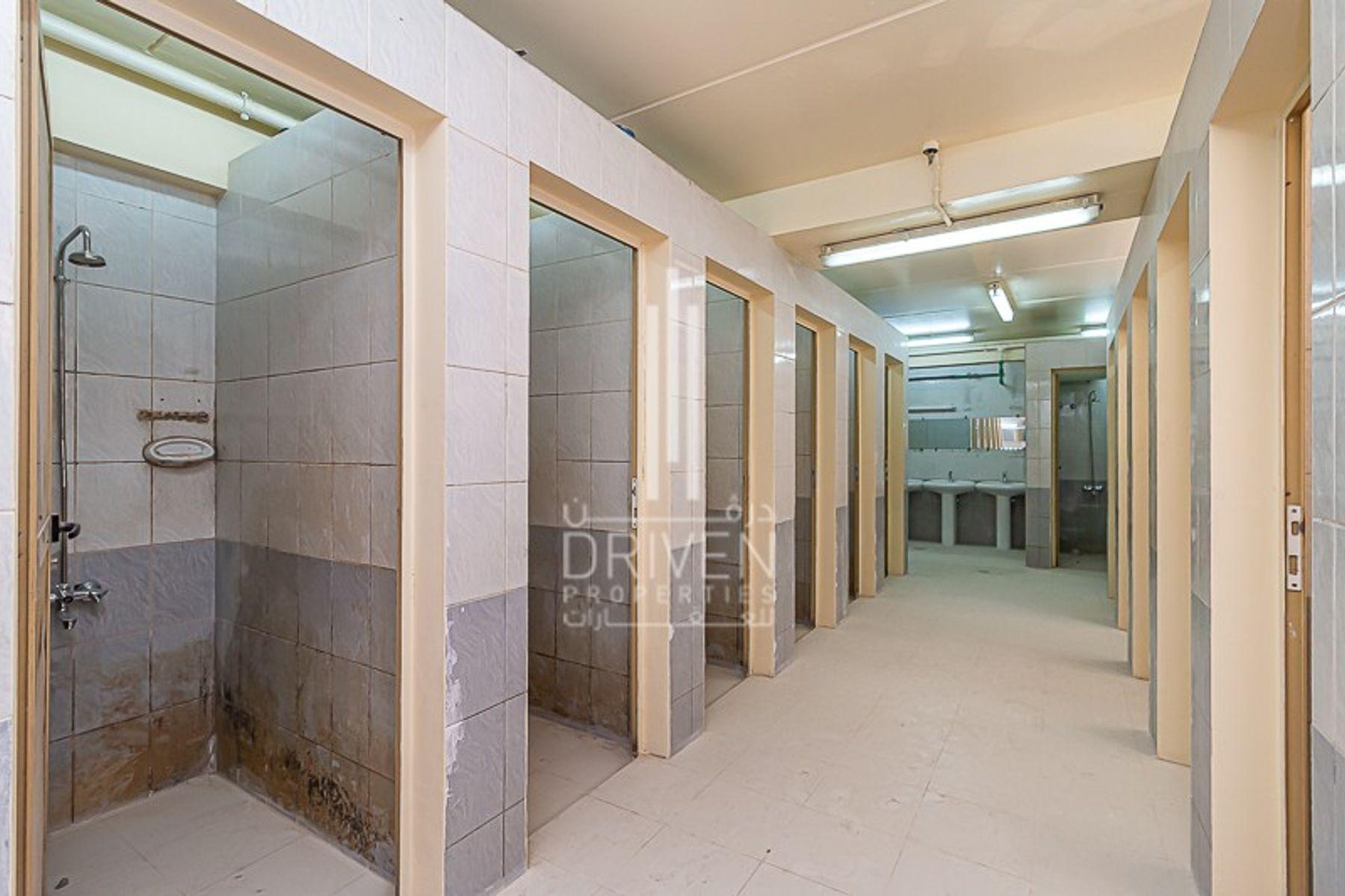 75,621 قدم مربع  مخيم عمال - للايجار - مجمع دبي للإستثمار