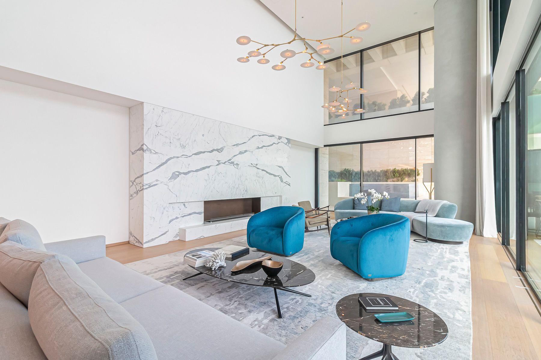 luxurious carerra marble fireplace inside a dubai apartment