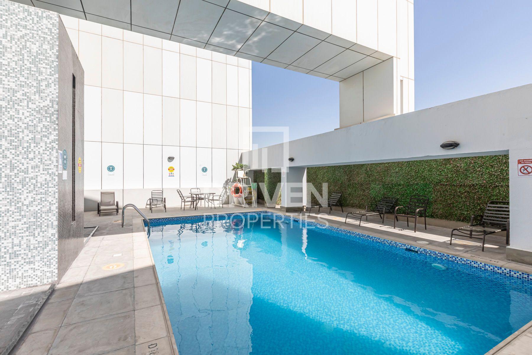 Studio for Sale in Giovanni Boutique Suites - Dubai Sports City